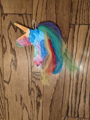 Rainbow Unicorn Wall Decoration - unicorn lying on a wood floor