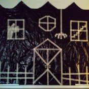 Big Garbage Bag Hanging Haunted House - finished house complete with picket fence and spider hanging down