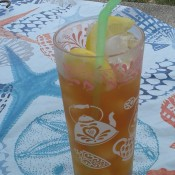 Iced tea with lemon slices.