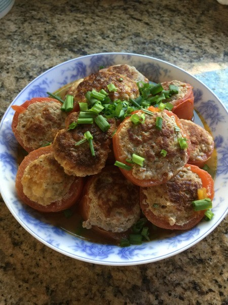A plate of turkey stuffed tomatoes.