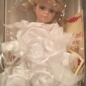 A bridal porcelain doll in a box.