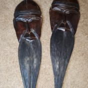 Carved wooden masks with long beards.