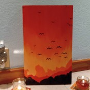 Sunset Mountain Painting - painting on tile floor with jar candles