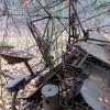 A piece of metal farm equipment.