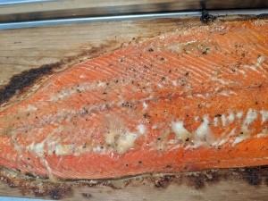 A grilled salmon filet on a cedar plank.