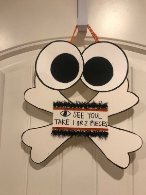 Halloween Sign - finished sign hanging on an over the door hook