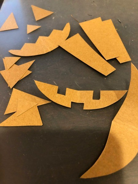 Pumpkin Wall Decoration - face pieces cut from paper