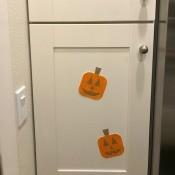 Pumpkin Wall Decoration - pumpkins glued to cabinet doors