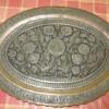 An ornate copper platter.