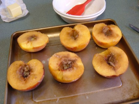 Half peaches with butter and cinnamon sugar.