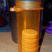 Sugar pills being stored in a prescription pill bottle.
