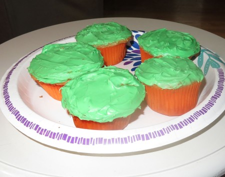 Green iced cupcakes.