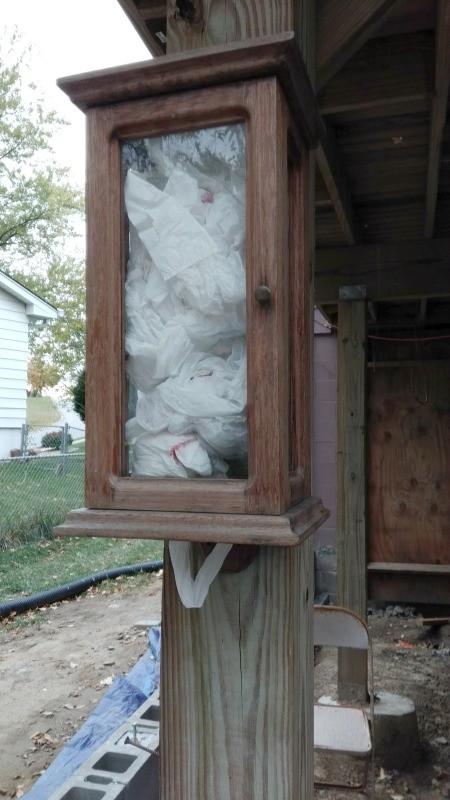 Dog Potty Clean Up Station - old wooden box used for poop bag dispenser outside