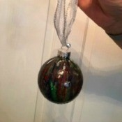 Poured Paint Christmas Bulb - finished bulb, reassembled and ribbon hanger added