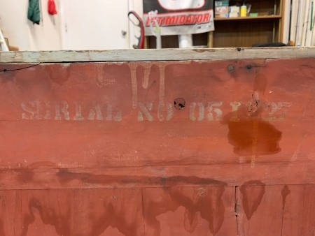 The back of a chest with a serial number.