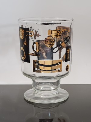 A decorative black and gold glass.