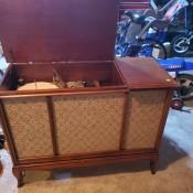 An open Sylvania stereo cabinet.
