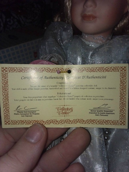 The certificate for a porcelain doll.