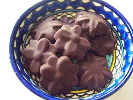 A bowl of handmade flower shaped chocolates.
