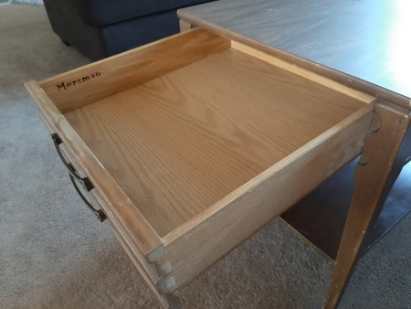 A drawer in a Mersman end table.