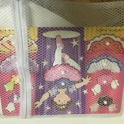 Storing a child's puzzle in a small zippered laundry bag.