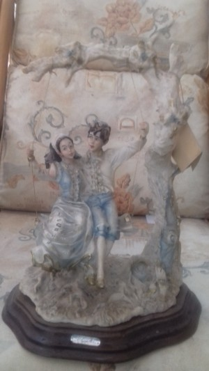 A decorative figurine of a couple.