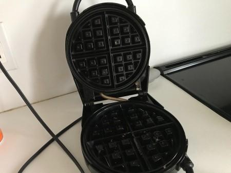 An open waffle maker.