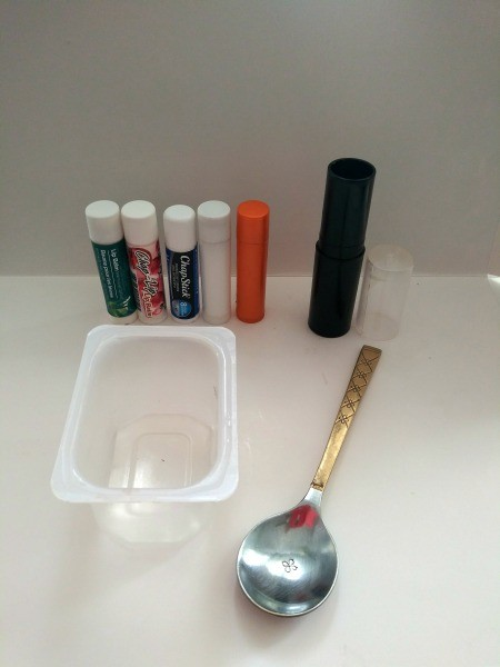 Large Lip Balm - oid lip balm tubes, plastic baby food container and a spoon