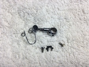 Sewing machine parts on a white surface.