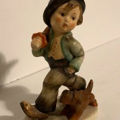 A Hummel figurine of a boy.