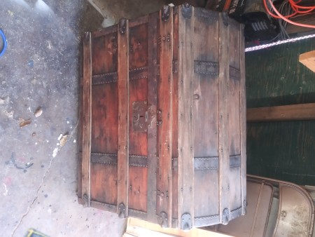 The back of a wooden chest.