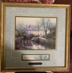 A Thomas Kinkade print in a official gold frame.