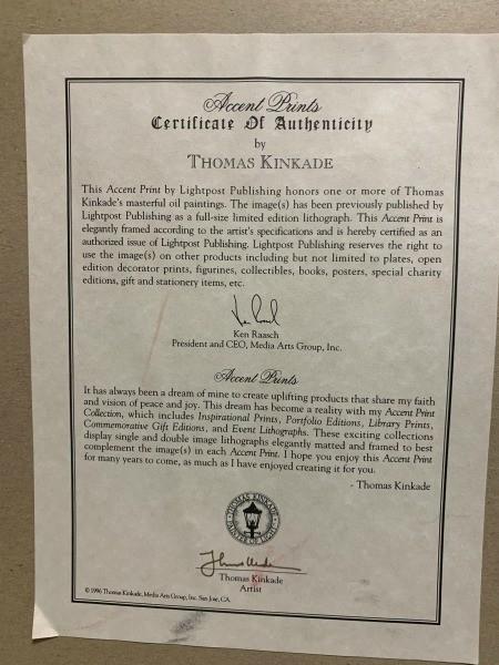 A certificate for a Thomas Kinkade print.