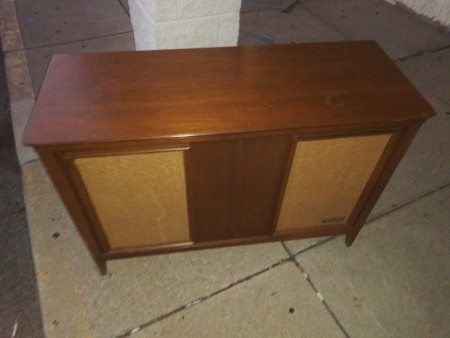 The front of a stereo console.