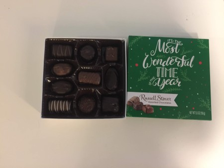 A small candy box with spaces for chocolates.