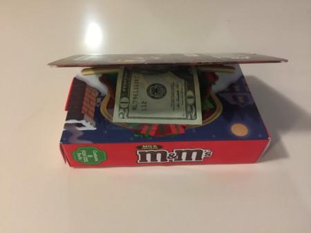 Money inside a M&M's Storybook.