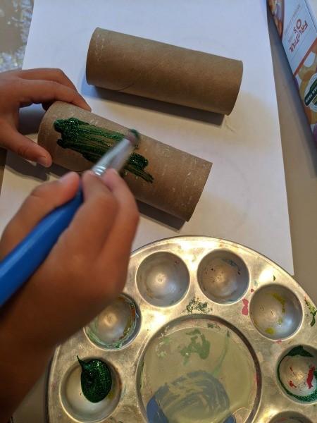 Christmas Dino Decoration - child painting TP tubes