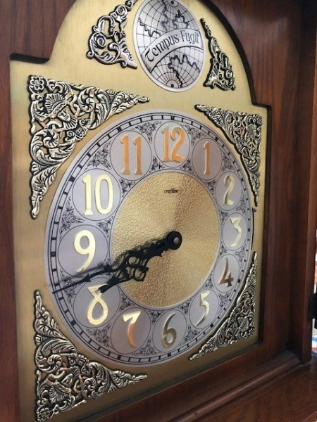 Close up on the face of a grandfather clock.
