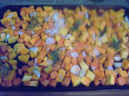 Chopped vegetables on a roasting pan.