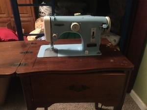 A blue vintage sewing machine.