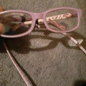 A pair of pink eyeglasses.