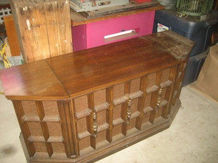 A wooden console stereo system