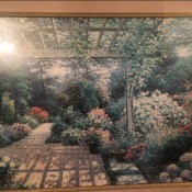A framed picture of a garden.