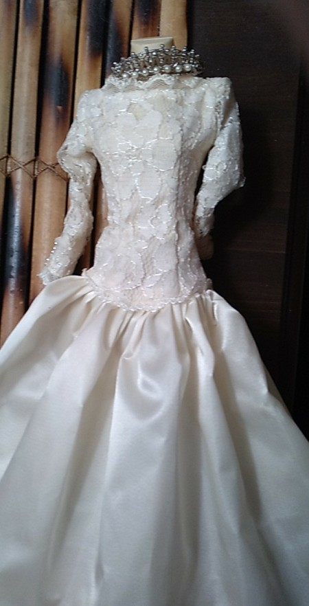 A white doll dress and tiara.