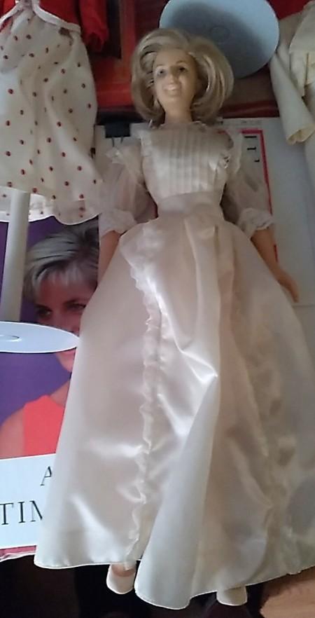 A doll wearing a white dress.
