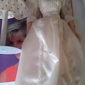 A doll wearing a white dress.