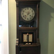 A grandfather clock style time punch clock.