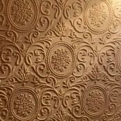 Ornate wallpaper with a raised design.