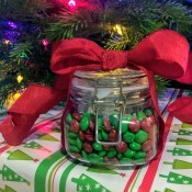 A candy jar with a red bow.