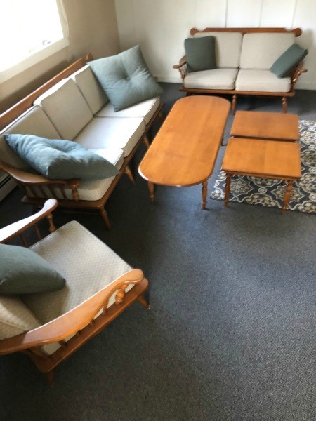 A living room set of Conant Ball furniture